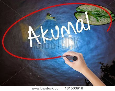 Woman Hand Writing Akumal With Marker Over Transparent Board