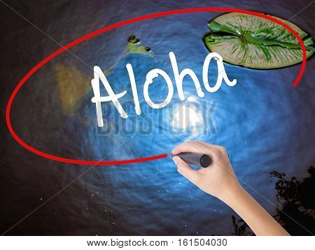 Woman Hand Writing Aloha  With Marker Over Transparent Board