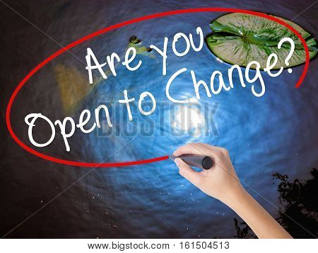 Woman Hand Writing Are You Open To Change? With Marker Over Transparent Board