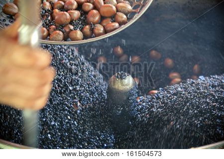 Chestnut roasting street food, Chestnut snacks are famous and popular in Yaowarat Road ( Chinatown of bangkok)