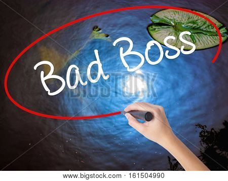 Woman Hand Writing Bad Boss With Marker Over Transparent Board