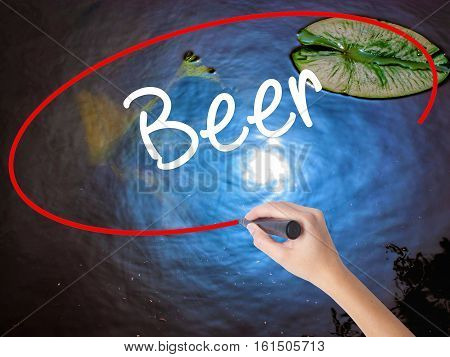 Woman Hand Writing Beer With Marker Over Transparent Board
