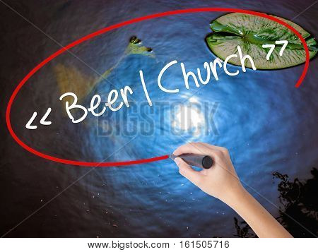 Woman Hand Writing Beer - Church With Marker Over Transparent Board.