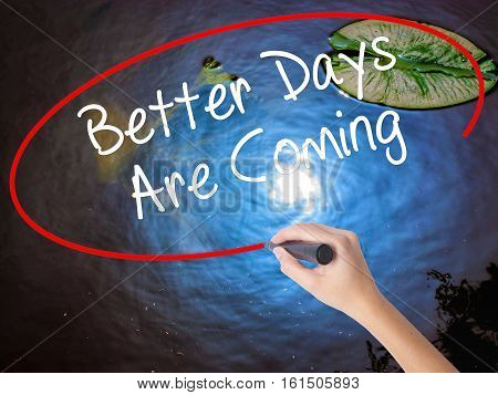 Woman Hand Writing Better Days Are Coming With Marker Over Transparent Board.