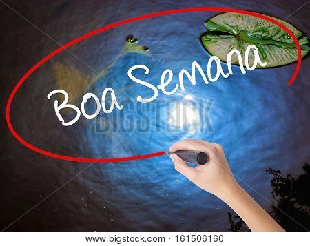 Woman Hand Writing Boa Semana   (good Weekin Portuguese)with Marker Over Transparent Board
