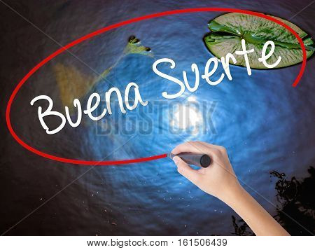 Woman Hand Writing Buena Suerte( Good Luck In Spanish) With Marker Over Transparent Board