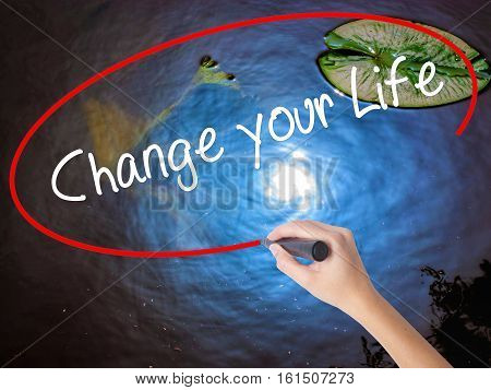 Woman Hand Writing Change Your Life With Marker Over Transparent Board