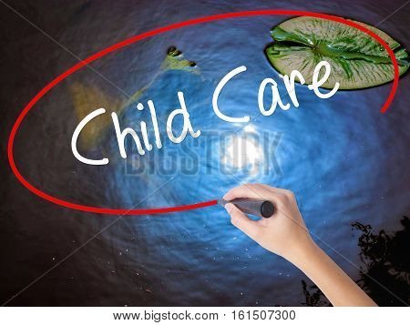 Woman Hand Writing Child Care With Marker Over Transparent Board