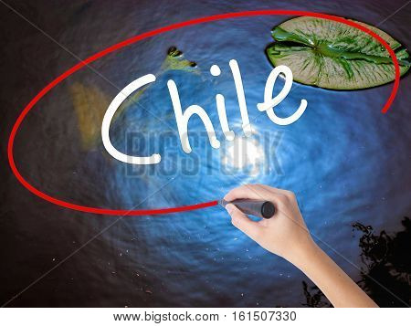 Woman Hand Writing Chile  With Marker Over Transparent Board