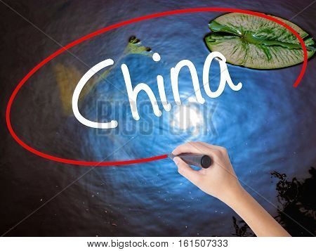 Woman Hand Writing China With Marker Over Transparent Board