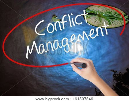 Woman Hand Writing Conflict Management With Marker Over Transparent Board.