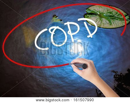 Woman Hand Writing Copd With Marker Over Transparent Board