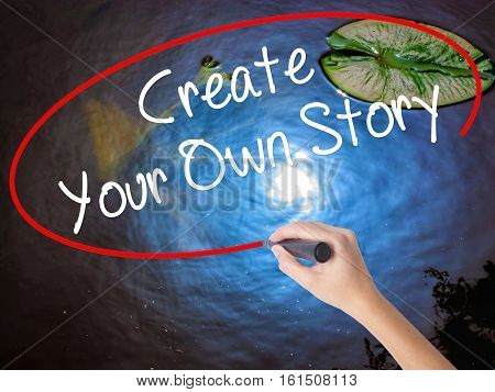Woman Hand Writing Create Your Own Story With Marker Over Transparent Board