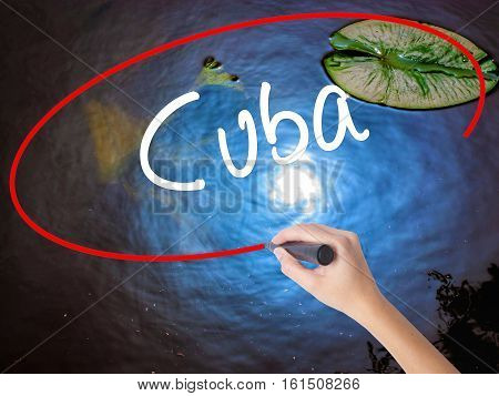 Woman Hand Writing Cuba With Marker Over Transparent Board