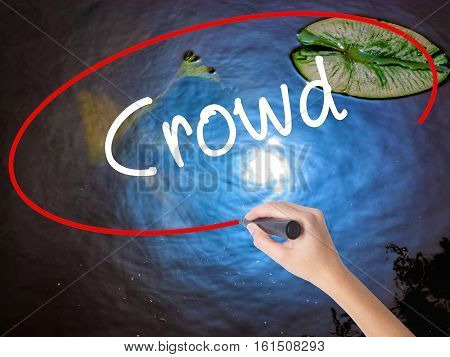 Woman Hand Writing Crowd With Marker Over Transparent Board