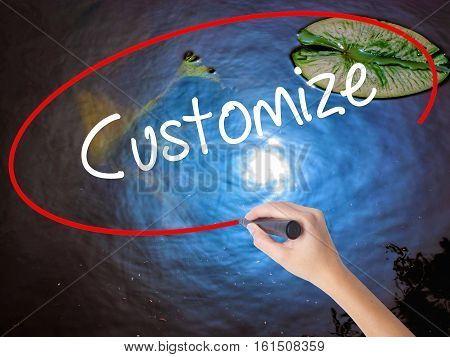 Woman Hand Writing  Customize With Marker Over Transparent Board