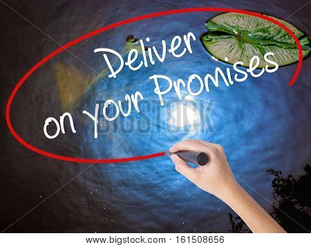 Woman Hand Writing Deliver On Your Promises With Marker Over Transparent Board