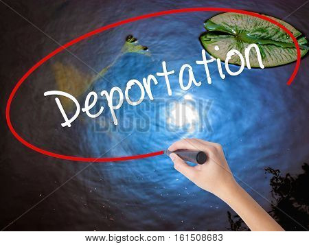 Woman Hand Writing Deportation  With Marker Over Transparent Board