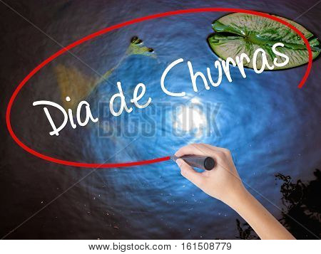 Woman Hand Writing Dia De Churras (barbecue Day In Portuguese) With Marker Over Transparent Board