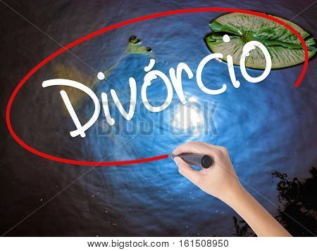 Woman Hand Writing Divorcio (divorce In Portuguese) With Marker Over Transparent Board.
