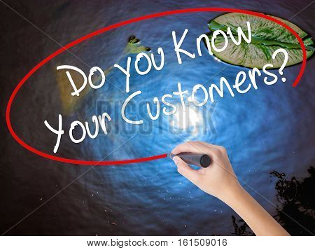 Woman Hand Writing Do You Know Your Customers? With Marker Over Transparent Board