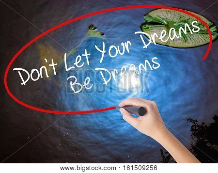 Woman Hand Writing Don't Let Your Dreams Be Dreams With Marker Over Transparent Board