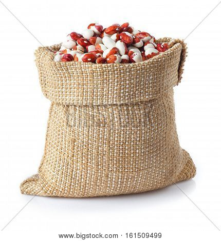 uncooked kidney beans in burlap sack isolated on white background. Pinto beans