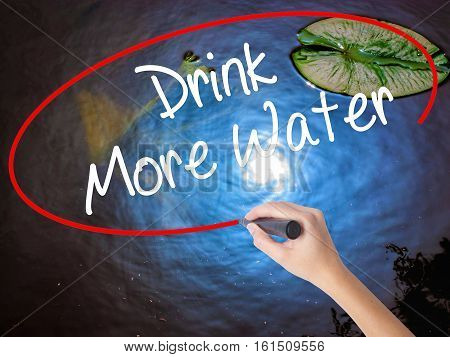 Woman Hand Writing Drink More Water With Marker Over Transparent Board
