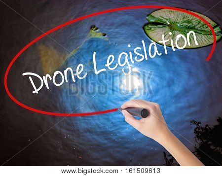 Woman Hand Writing Drone Legislation With Marker Over Transparent Board