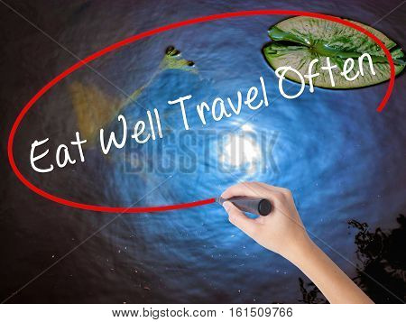 Woman Hand Writing Eat Well Travel Often With Marker Over Transparent Board
