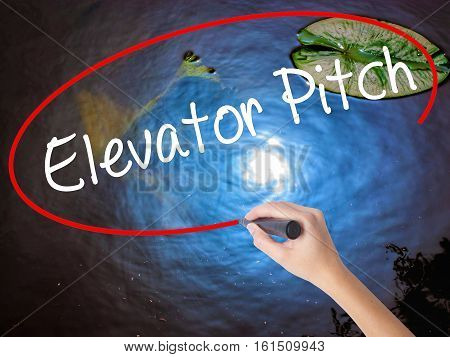 Woman Hand Writing Elevator Pitch With Marker Over Transparent Board
