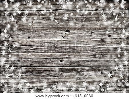 brown wood wall texture with white snow and stars. Christmas background