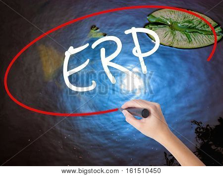 Woman Hand Writing  Erp (enterprise Resource Planning)   With Marker Over Transparent Board