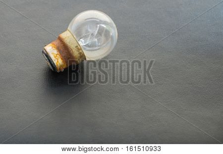 Light bulbs on the black leather background. Unavailable