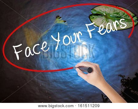 Woman Hand Writing Face Your Fears With Marker Over Transparent Board