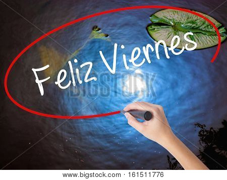 Woman Hand Writing Feliz Viernes (happy Friday In Spanish)  With Marker Over Transparent Board