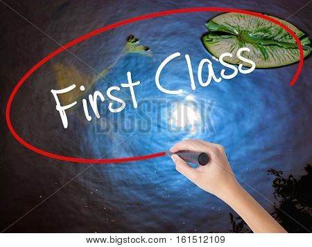 Woman Hand Writing First Class With Marker Over Transparent Board