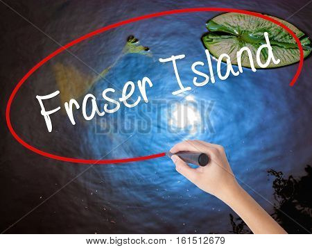 Woman Hand Writing Fraser Island With Marker Over Transparent Board.