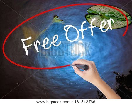 Woman Hand Writing Free Offer  With Marker Over Transparent Board