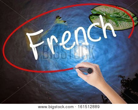 Woman Hand Writing French With Marker Over Transparent Board