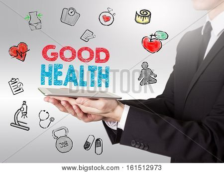 Good Health concept. Healty lifestyle background. Man holding a tablet computer.