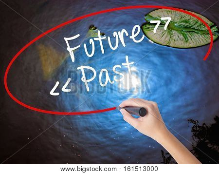 Woman Hand Writing Future - Past With Marker Over Transparent Board.
