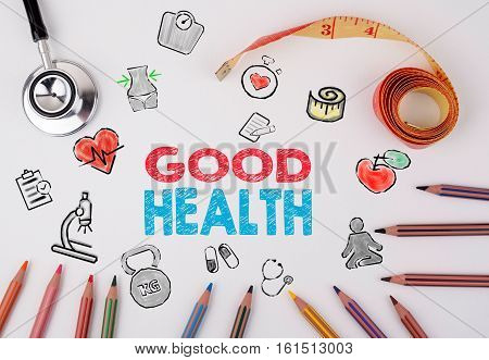 Good Health concept. Healty lifestyle background. Stethoscope, pencils and tape measure on the table