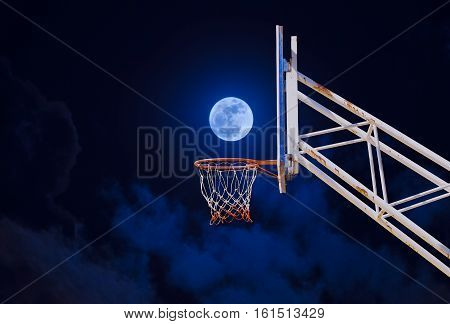 moon in a basketball hoop. concept of success