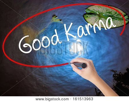 Woman Hand Writing  Good Karma With Marker Over Transparent Board