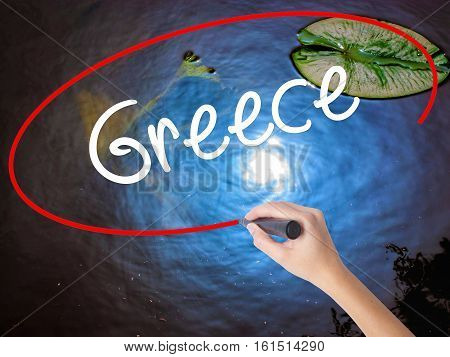 Woman Hand Writing Greece  With Marker Over Transparent Board