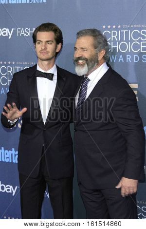 SANTA MONICA - DEC 11: Andrew Garfield, Mel Gibson at The 22nd Annual Critics' Choice Awards at Barker Hangar on December 11, 2016 in Santa Monica, California