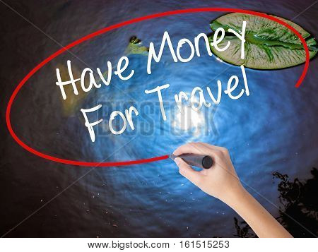 Woman Hand Writing Have Money For Travel  With Marker Over Transparent Board