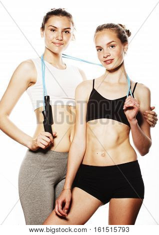 two sport girls measuring themselves isolated on white, inflated press