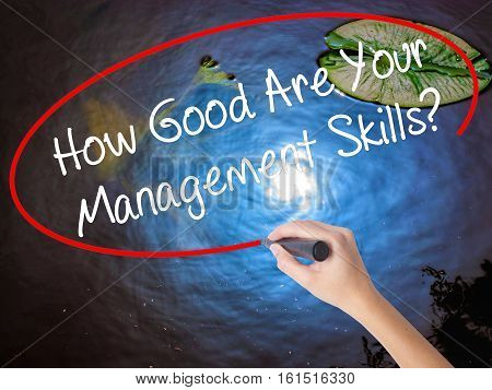 Woman Hand Writing How Good Are Your Management Skills? With Marker Over Transparent Board
